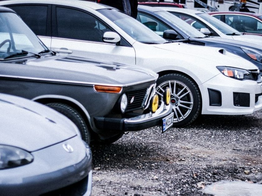 The above stock image shows a line of cars.