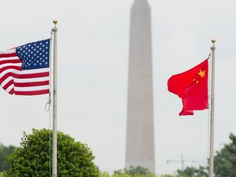 The U.S. and Chinese flags wave in the wind before a full-honor welcome ceremony for Chinese Gen. Fang Fenghui, chief of the General Staff of the People's Liberation Army, at the Pentagon, May 15, 2014.