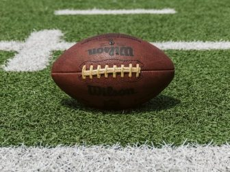 Brown and black Wilson football on a field
