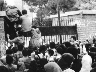 Iranian students climb up the U.S. embassy gates in Tehran on Nov. 4, 1979.