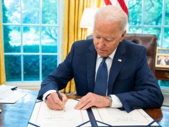 """President Joe Biden signs S.409, an Act """"to provide the availability of amounts for customer education initiatives and non-awards expenses of the Commodity Futures Trading Commission Whistleblower Program, and for other purposes,"""" on Tuesday, July 6, 2021, in the Oval Office of the White House. (Official White House Photo by Adam Schultz)"""