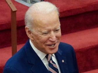 President Joe Biden smiles.