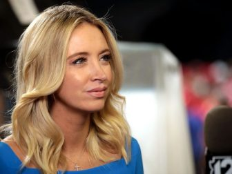 """Kayleigh McEnany speaking with the media at a """"Keep America Great"""" rally for President of the United States Donald Trump at Arizona Veterans Memorial Coliseum in Phoenix, Arizona."""