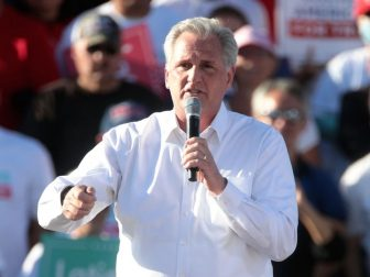 """House Minority Leader Kevin McCarthy speaking with supporters of President of the United States Donald Trump at a """"Make America Great Again"""" campaign rally at Phoenix Goodyear Airport in Goodyear, Arizona."""