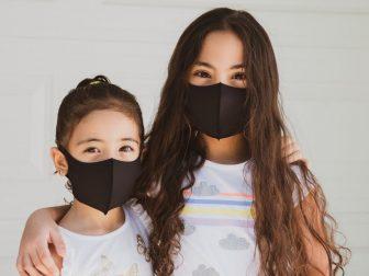 Elementary school girls wearing masks