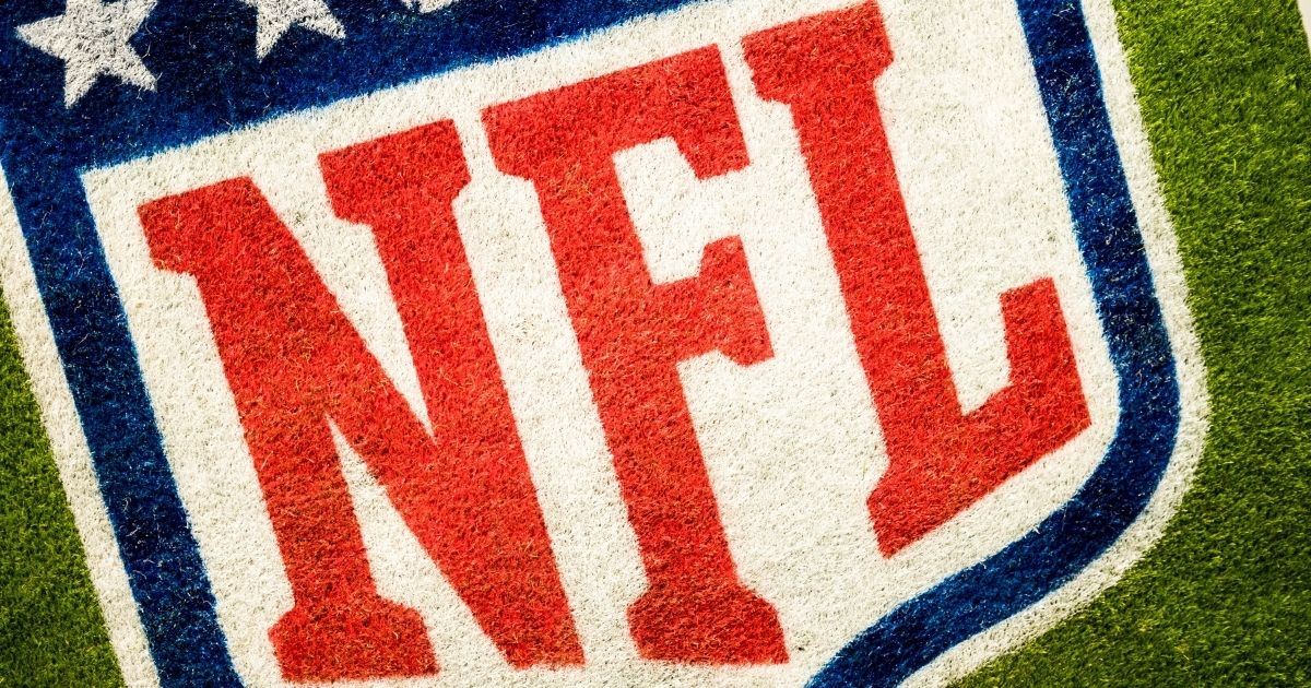 The NFL grass logo is shown in the stock image above.