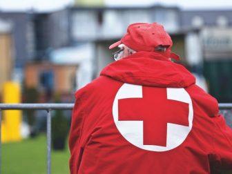 Man in a Red Cross jacket