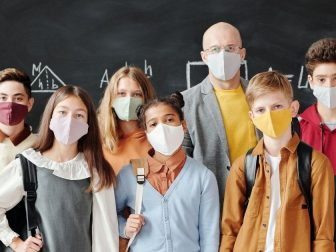 Students and teacher wearing masks