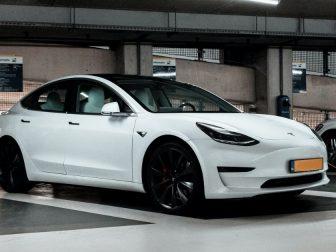 White Tesla charging