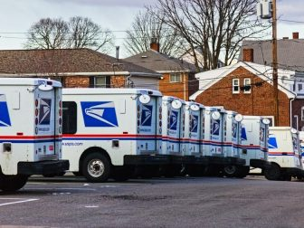 United States Postal Service mail vans lined up at the Waltham, Massachusetts mail handling facility this winter