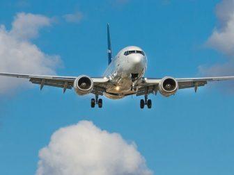 White airplane mid-air