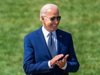 President Joe Biden claps during a clean car event Thursday, August 5, 2021 on the South Lawn of the White House.