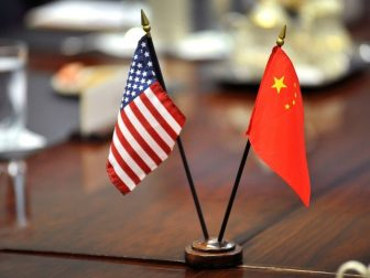 The American and Chinese flags stand at center table shortly before Deputy Secretary of Defense Ashton B. Carter welcomes Deputy Chief of the General Staff of the People's Liberation Army Cai Yingting of China to a meeting at the Pentagon, August 23, 2012. (DoD Photo By Glenn Fawcett)
