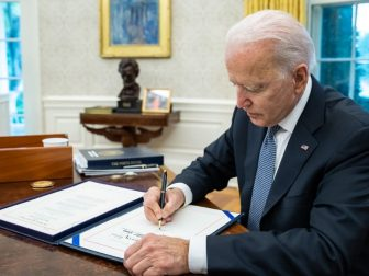 President Joe Biden signs the Emergency Security Supplemental Appropriations Act of 2021, Friday, July 30, 2021, in the Oval Office at the White House. (Official White House Photo by Adam Schultz)