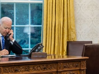 President Joe Biden talks on the phone with First Lady Jill Biden, Monday, Aug. 2, 2021, in the Oval Office of the White House.