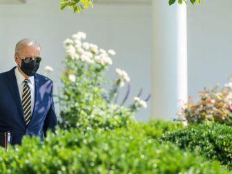 President Joe Biden walks through the Rose Garden of the White House on Wednesday, July 28, 2021, to the Oval Office.