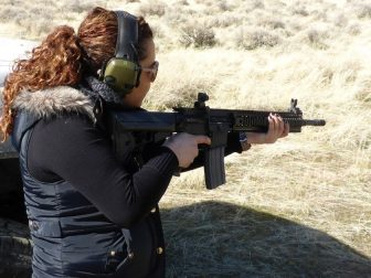 A woman holds an AR-15 rifle during shooting practice on Feb. 12, 2017.