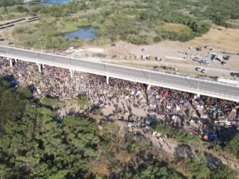 A Fox News drone captures a look at the makeshift migrant camp under the international bridge in Del Rio, Texas, on Sept. 19, 2021.