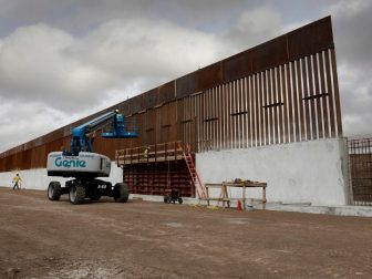 Construction crews work to erect levee wall system in a remote area south of Weslaco, Texas in the U.S. Border Patrol's Rio Grande Valley Sector. Jan. 13, 2019. CBP Photo by Glenn Fawcett