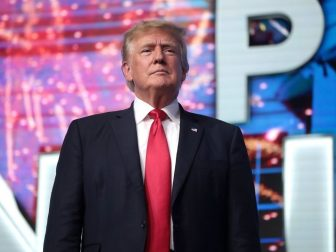 """Former President of the United States Donald Trump speaking with attendees at the """"Rally to Protect Our Elections"""" hosted by Turning Point Action at Arizona Federal Theatre in Phoenix, Arizona."""
