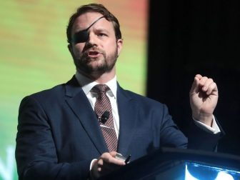 U.S. Congressman Dan Crenshaw speaking with attendees at the 2019 Student Action Summit hosted by Turning Point USA at the Palm Beach County Convention Center in West Palm Beach, Florida.