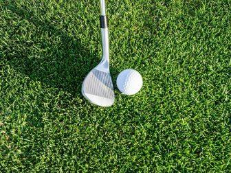 Golf club on green grass