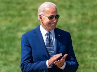 President Joe Biden claps during a clean car event Thursday, August 5, 2021 on the South Lawn of the White House. (Official White House Photo by Cameron Smith)